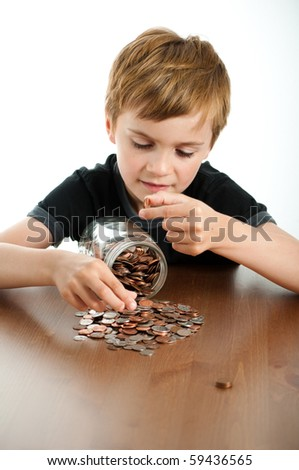 Happy Boy Counting Money from Glass Jar - stock photo