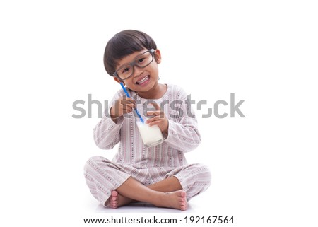 Happy boy drink milk isolated on white