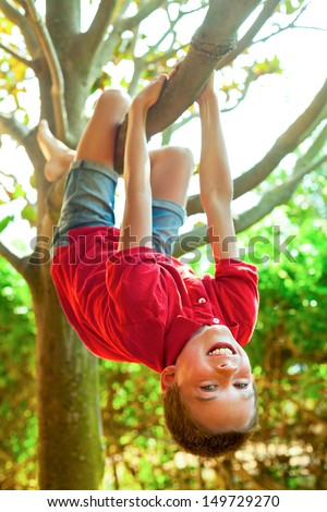 Happy boy enjoying  summer day in a garden - stock photo
