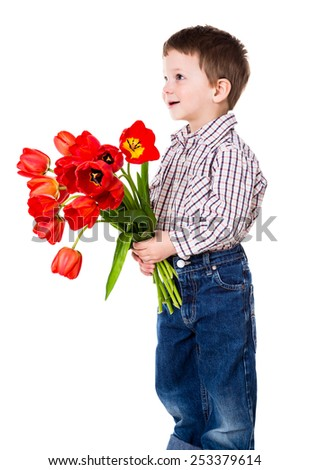 Happy boy gives a bouquet of red tulips, isolated on white