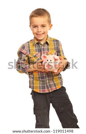 Happy boy holding piggy bank isolated on white background - stock photo