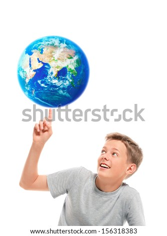 Happy boy holding planet earth on his finger. Elements of this image furnished by NASA