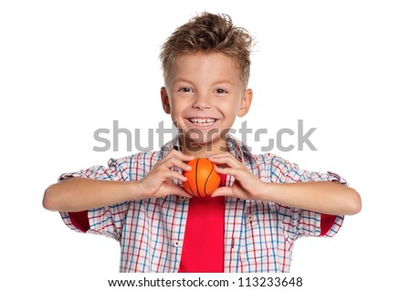 Happy boy holding small basketball ball in hand isolated on white background - stock photo