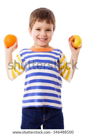 Happy boy holds a orange and apple, isolated on white - stock photo