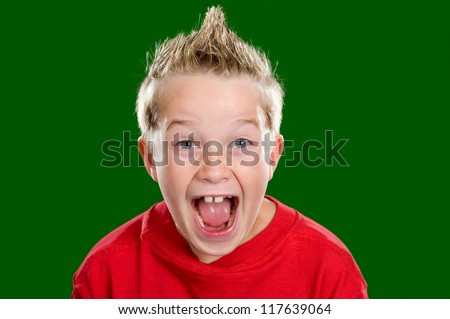 happy boy in front of green background - stock photo