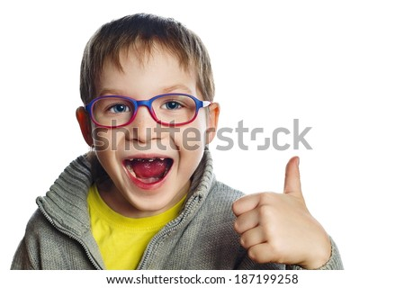 Happy boy in glasses with open mouth and caries, isolated on a white background - stock photo