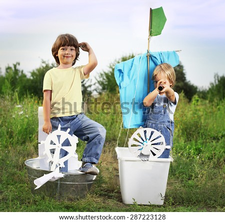 happy boy in hand made ship outdoors play - stock photo