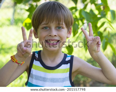 happy boy in the park, sunny day - stock photo