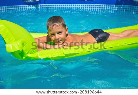 happy boy in the swimming pool - stock photo
