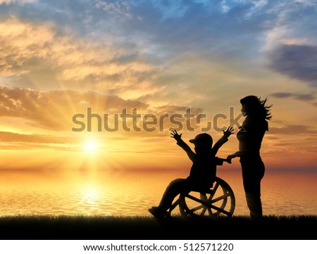 Happy boy in wheelchair and nurse sea sunset. Happy disabled child concept