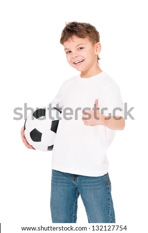 Happy boy in white T-shirt with soccer ball showing thumbs up, isolated on white background - stock photo