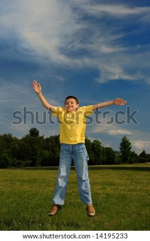 happy boy jumping for joy - stock photo