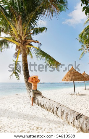 happy boy on tropical beach