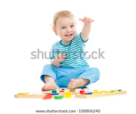 Happy boy playing colorful balls isolated on white - stock photo