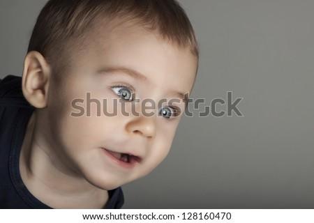 happy boy portrait on grey background - stock photo
