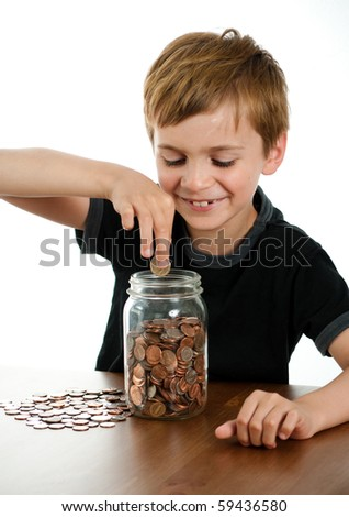 Happy Boy Putting Money in Glass Jar - stock photo