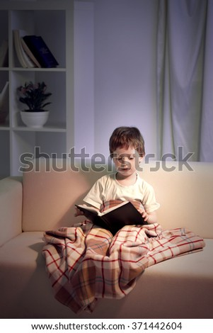 happy boy read book home - stock photo