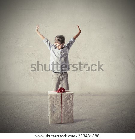 Happy boy receiving a big gift  - stock photo