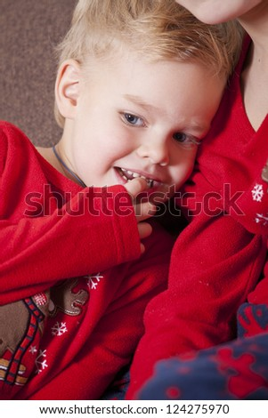 Happy boy resting on brothers shoulder looking away - stock photo