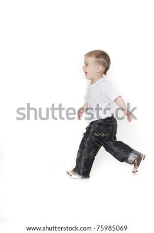 happy boy running over white - stock photo