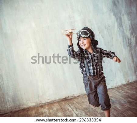 Happy boy running with plane - stock photo