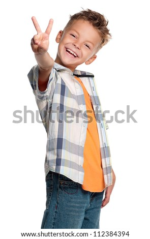 Happy boy showing victory sign isolated on white background - stock photo