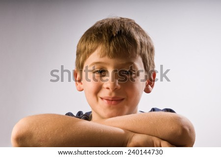 Happy boy smirking - stock photo