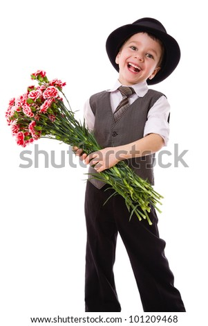 Happy boy standing with a bouquet of pink carnations, isolated on white - stock photo