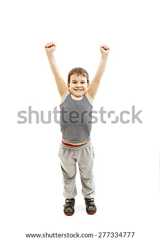 Happy boy standing with arms open. Isolated on white background