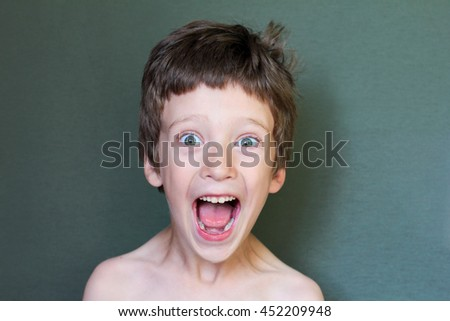 happy boy than surprised. The boy opened his mouth - stock photo