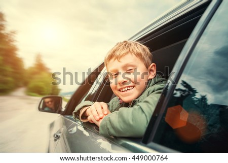 Happy boy travel with father in auto