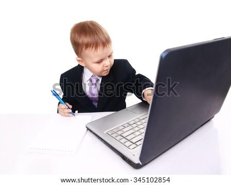 Happy boy using laptop computer - stock photo