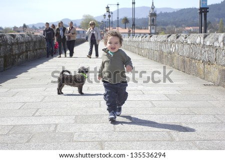 happy boy walking in the street - stock photo