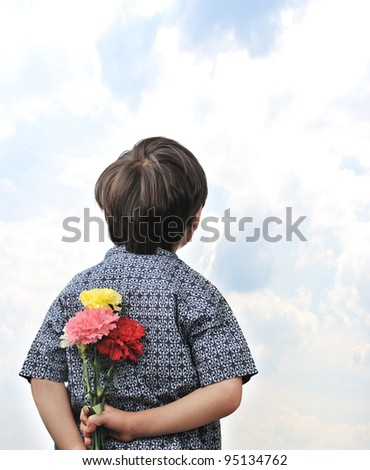 Happy boy with a bouquet of tulips - stock photo