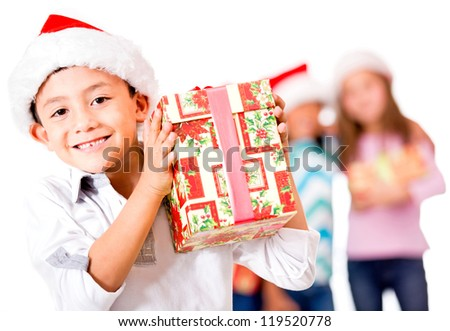 Happy boy with a Christmas gift - isolated over a white background - stock photo