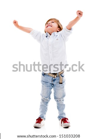 Happy boy with arms up celebrating - isolated over a white background  - stock photo