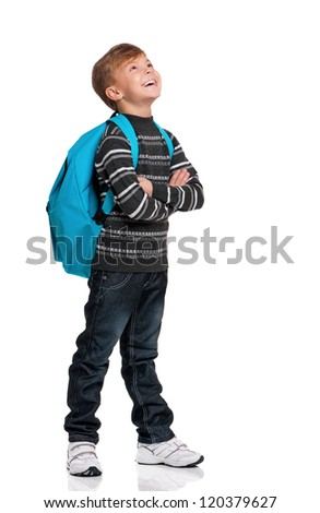 Happy boy with backpack looking up isolated on white background