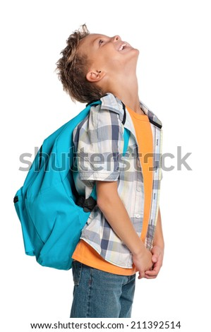 Happy boy with backpack looking up isolated on white background - stock photo