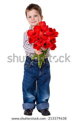 Happy boy with bouquet of a red tulips, isolated on white