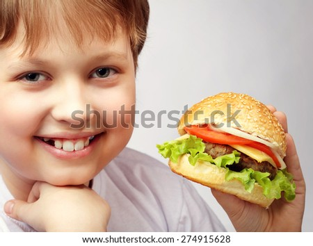 happy boy with burger - stock photo