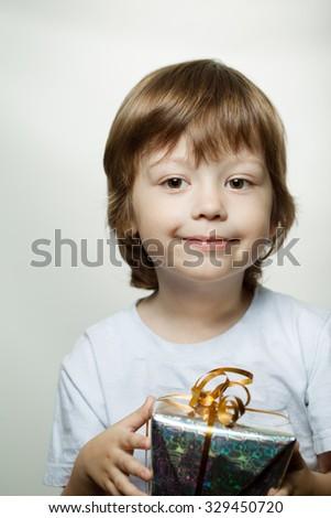 happy boy with christmas gift-box - stock photo