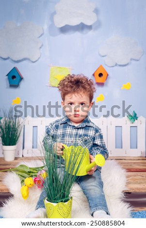 Happy boy with flowers. Yellow and pink tulips, March 8, Mother's Day - stock photo