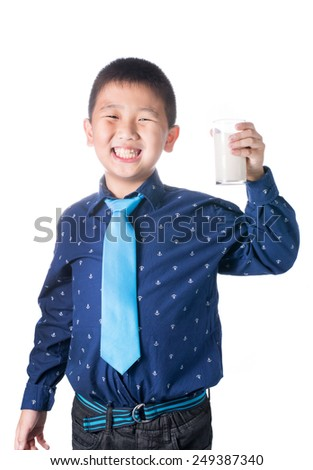 Happy boy with glass of milk in hand isolated on white background.