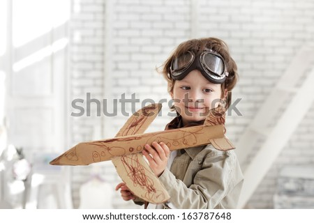 happy boy with jet airplane in hand - stock photo