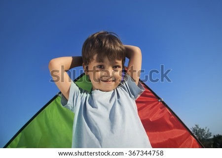 happy boy with kite outdoors - stock photo