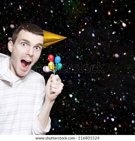 Happy Boy With Look Of Excitement Wearing Party Hat Celebrating His Birthday With Balloons And Confetti - stock photo
