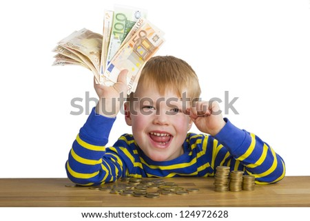 Happy boy with money in his hand - stock photo