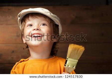 happy boy with paint brush - stock photo