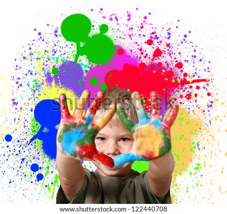 Happy boy with paint smeared hands. - stock photo