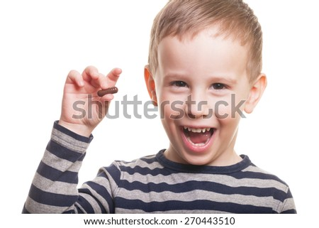 Happy boy with pill on isolated white - stock photo